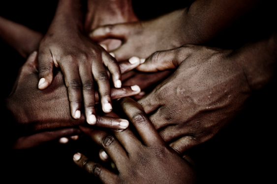 African hands together